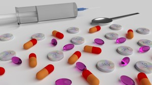 Pill and a syringe