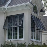 Improve the look of your home with Bahama Shutters by Southern Extrusion, Inc. Call Palmetto Outdoor Spaces for your home improvement estimate.