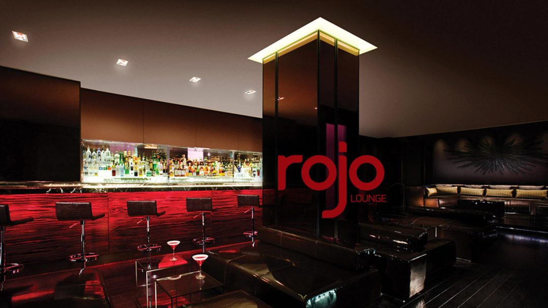 Interior shot of Rojo Lounge with logo