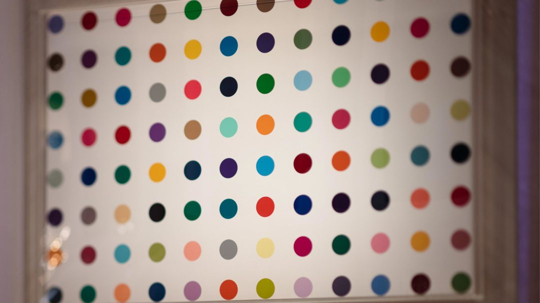 Colored polka dots on white canvas