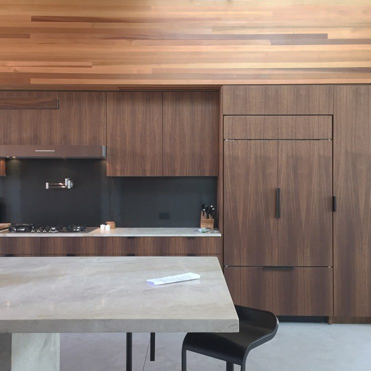 Kitchen Cabinets made with Walnut and Metal Backsplash