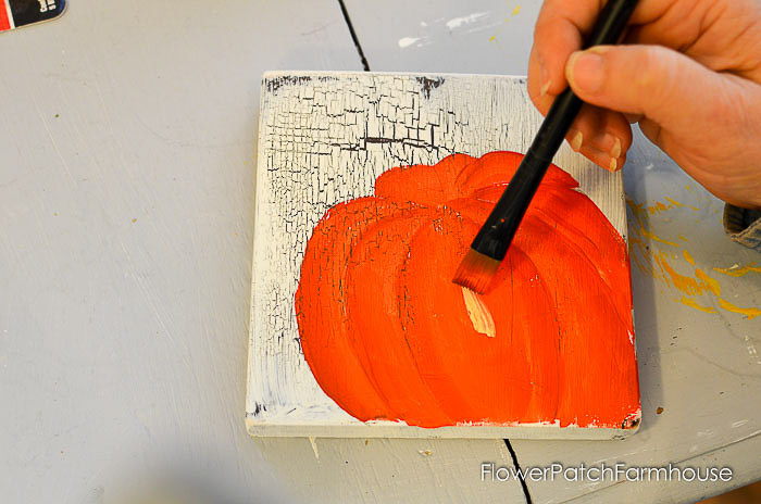 Adding highlights to orange pumpkin acrylic painting