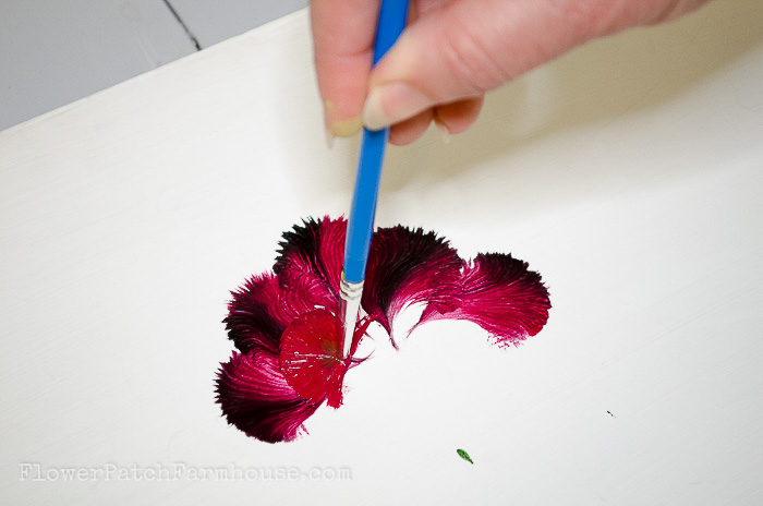 Second layer of petals painting a carnation with a round brush, pamelagroppe.com