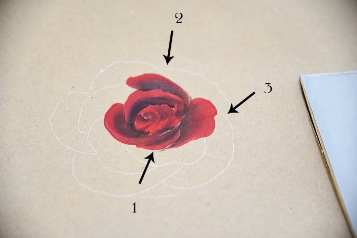 Layering on more petals painting a red rose, pamelagroppe.com