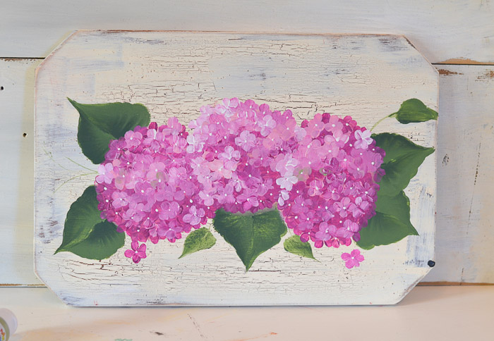 Painted pink hydrangeas on a crackled background