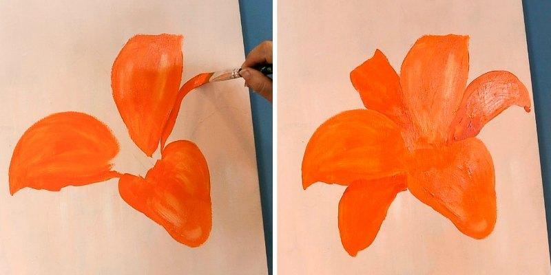 Painting an orange poppy in progress, add underpetals in a darker orange color