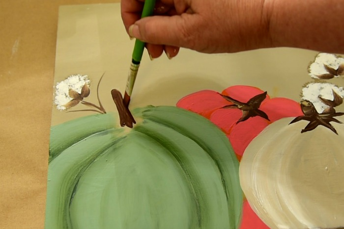 Painting a pumpkin stem on a diy happy fall sign