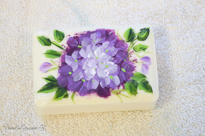 Purple flowers painted on soap, pamela groppe art