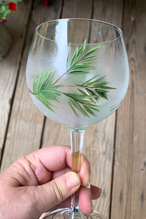 wine glass painting with a frost finish and pine bough, pamela groppe art
