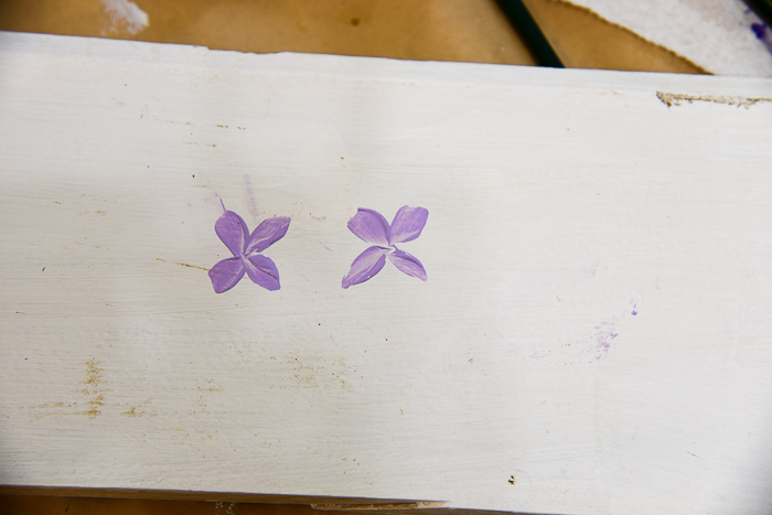 Paint petal strokes to begin violets