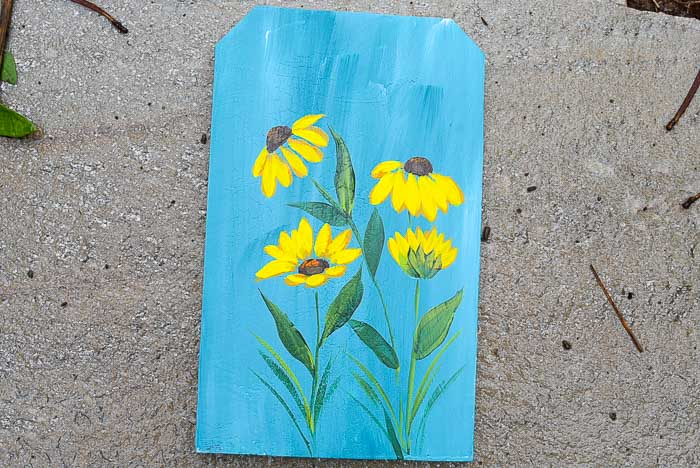 Painting of Black Eyed Susans in acrylic paints on fence board piece