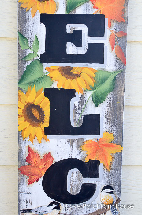 Paint fall leaves on DIY autumn inspired sign