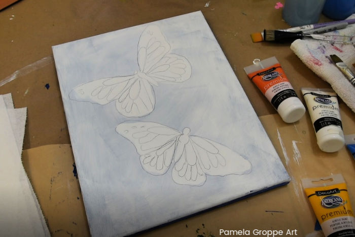 white canvas with tracing of Monarch butterflies to paint