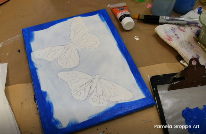 Painting background edges in cerulean blue, how to paint a butterfly