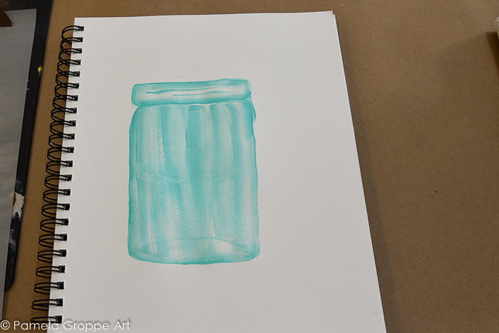 paint bottom of jar visible through the glass