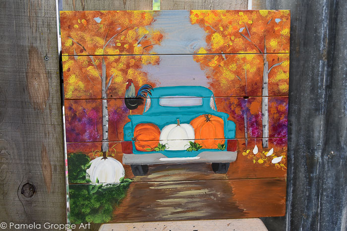 Fall truck with pumpkins painted on pallet wood canvas.