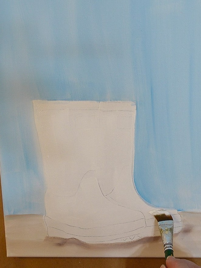 Paint rainboots with white and a large flat brush