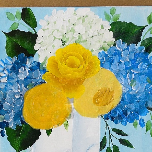 Paint yellow roses in boots finishing center