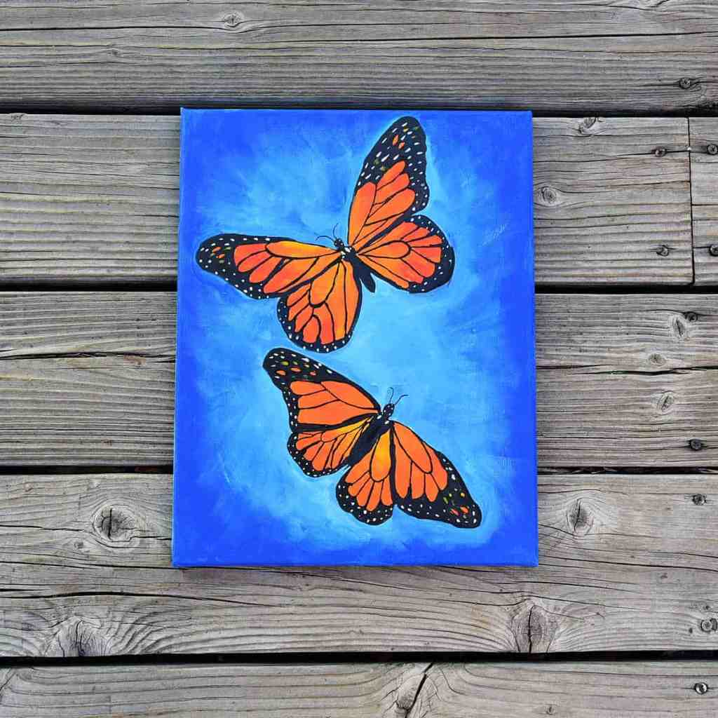 Paint a monarch butterfly