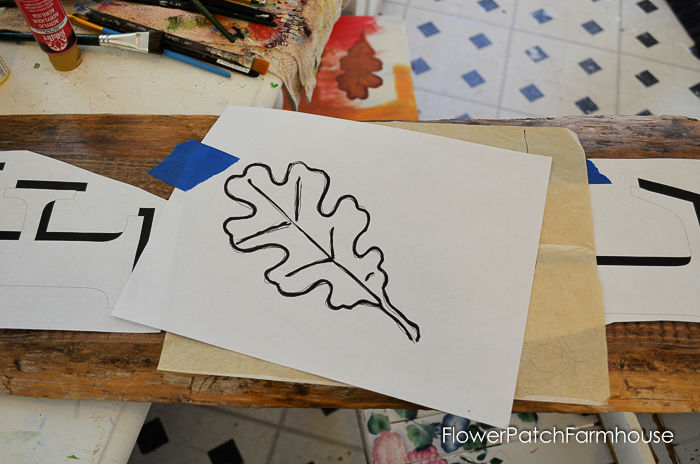 oak leaf pattern being transferred to surface with white graphite paper