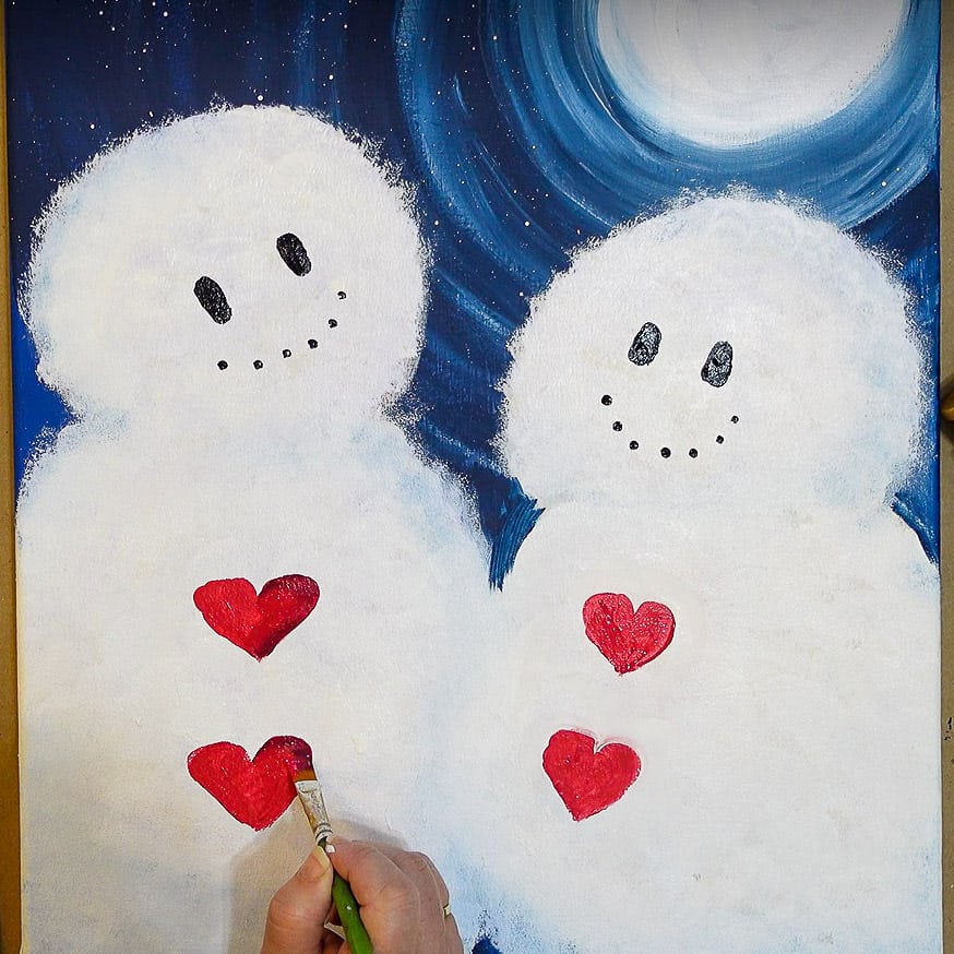Dot black in smile and then shade heart buttons on snow couple