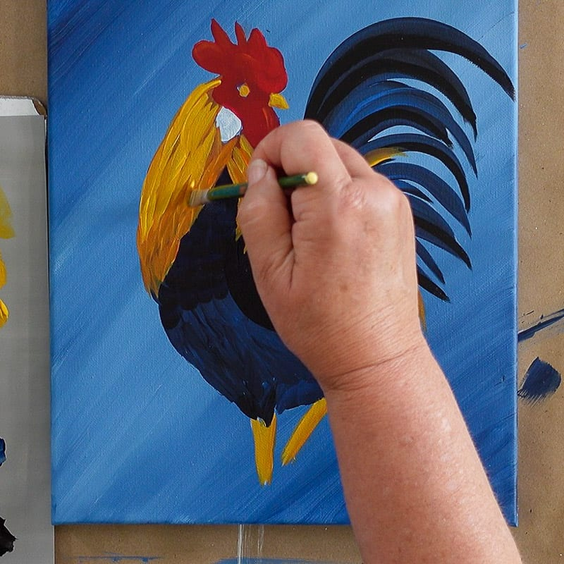 brighten neck feathers of rooster with yellow paint, pamela groppe art