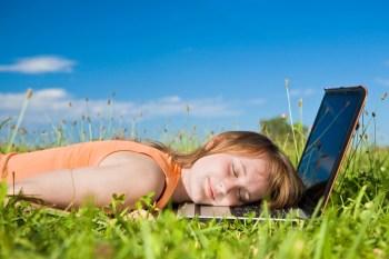 young beautiful girl sleep on laptop outdoor
