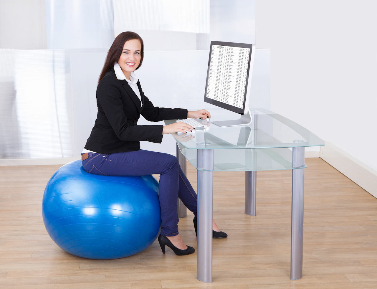 8 Desk Exercises To Boost Your Energy Before You Reach For