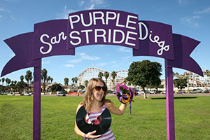 """Shanle symbolically """"breaks a record"""" at PurpleStride San Diego when her volunteer-led team surpasses the previous year in fundraising and participants."""
