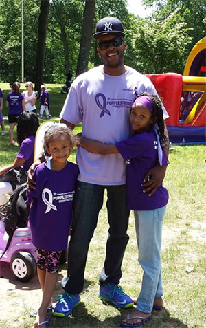 Terry spending time with his daughters at PurpleStride Connecticut 2014.