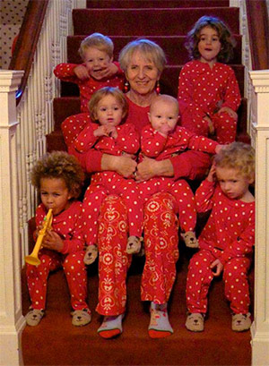 """""""Koko"""" sitting with most of her grandchildren by her side."""