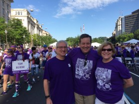 Chief Communications Officer Michael Rosen and Chief Science Officer Lynn Matrisian participate in walk with emcee Ed Henry