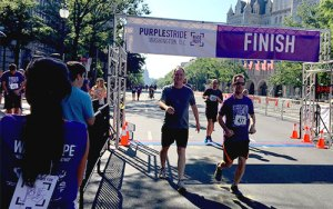 Walkers and runners cross finish line at PurpleStride Washington D.C., the walk to end pancreatic cancer