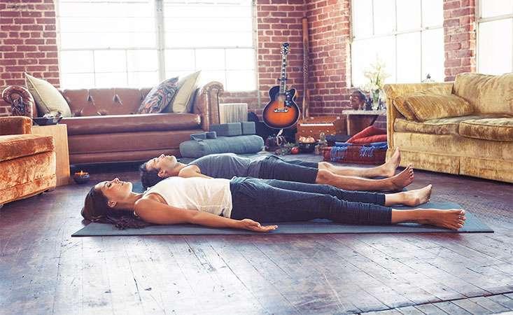Yoga teacher Lauren Eckstrom demonstrates simple breathing exercise to relieve stress