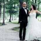 Joy Barber in a white wedding dress posing with her husband, Steve.