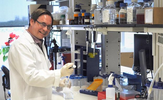 Michael Curran, PhD, in his science lab for pancreatic cancer research.