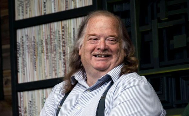 "Food critic Jonathan Gold smiles before an audience at Sundance film premier of ""City of Gold."""
