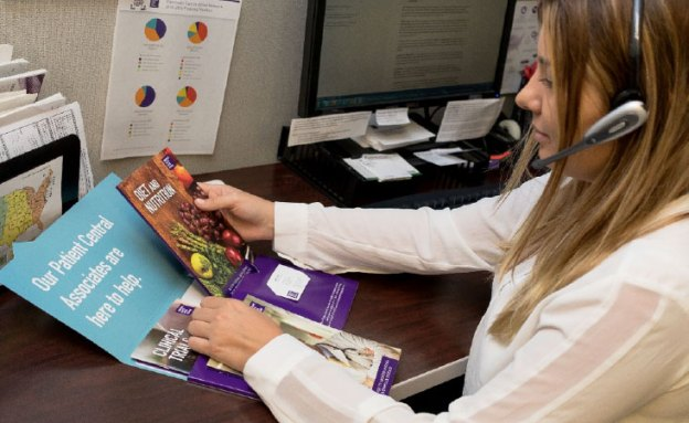 PanCAN Patient Central Associate speaks with caller while compiling a free information packet.