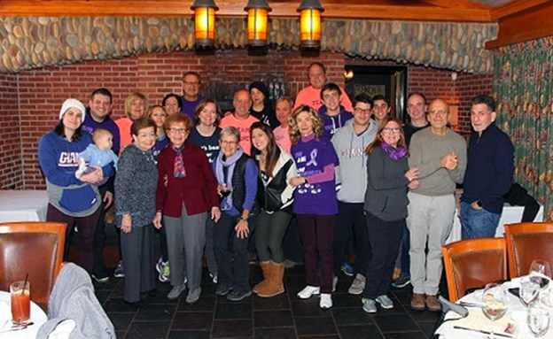 The family of a woman who fought pancreatic cancer gathers after a 5K walk to end the disease