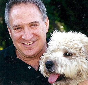 Peter Kenner photographed with his dog before his pancreatic neuroendocrine cancer diagnosis