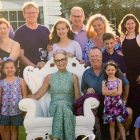 Multi-generational family surrounding their matriarch, a pancreatic cancer survivor