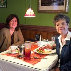 Pancreatic neuroendocrine tumor survivor enjoys dinner at a restaurant with a friend