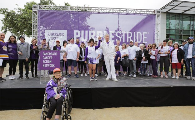 Alex Trebek with pancreatic cancer survivors at PanCAN's PurpleStride.