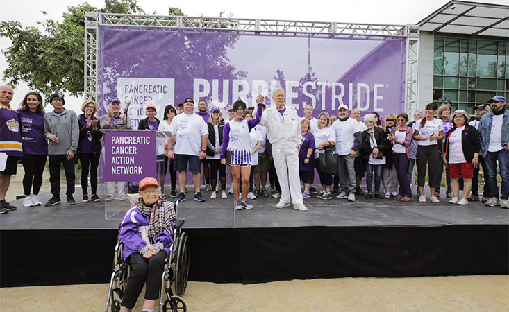 Alex Trebek with pancreatic cancer survivors at PanCAN's PurpleStride.