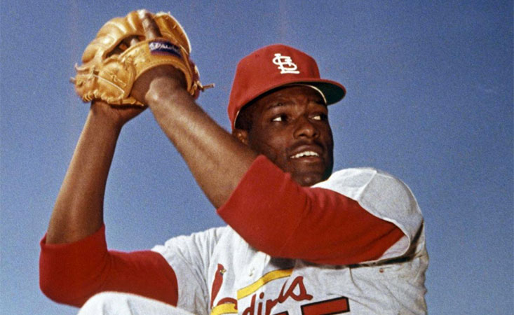 Baseball Hall of Famer Bob Gibson winds up to throw one of his famous right-handed pitches.