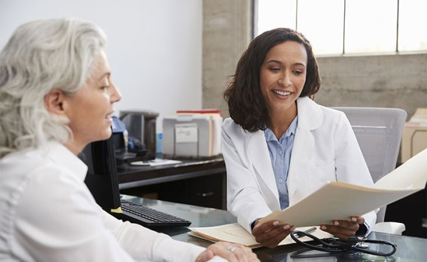 Pancreatic cancer patient reviews her molecular profile report with her doctor