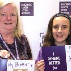 Mom and daughter hold photos of family member who inspired their pancreatic cancer volunteerism