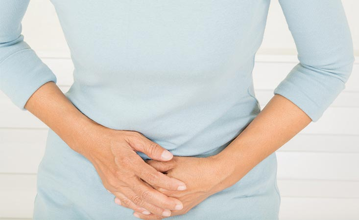 Woman experiencing stomach pain, a pancreatic cancer symptom