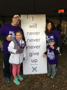 Pancreatic cancer survivor with his family at Pancreatic Cancer Action Network's PurpleStride