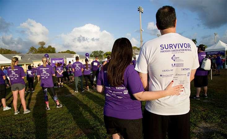 Pancreatic cancer survivor with participant at PanCAN's PurpleStride walk/run event